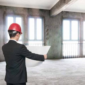 Architects, estimators, and engineers review sites before concrete scanning